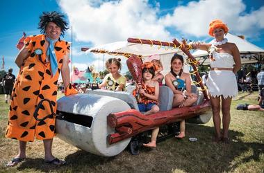 Festival goers dressed as the Flintstones on day 2 of Camp Bestival 2015, Lulworth Castle - Dorse