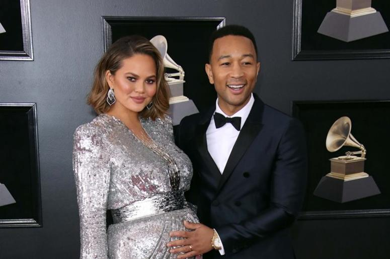 Jan 28, 2018; New York, NY, USA; Chrissy Teigen (L) and John Legend arrive at the 60th Annual Grammy Awards at Madison Square Garden