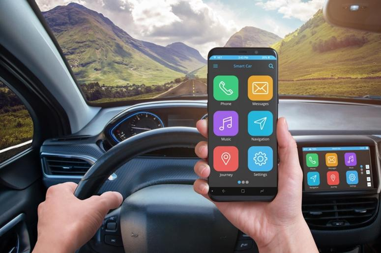 Driver holding smart phone with modern app phone with a modern apps