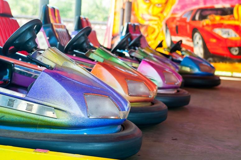 Colorful electric bumper car in the fairground attractions at amusement park