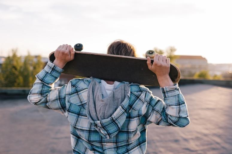 Street subculture. Skateboarder with skateboard
