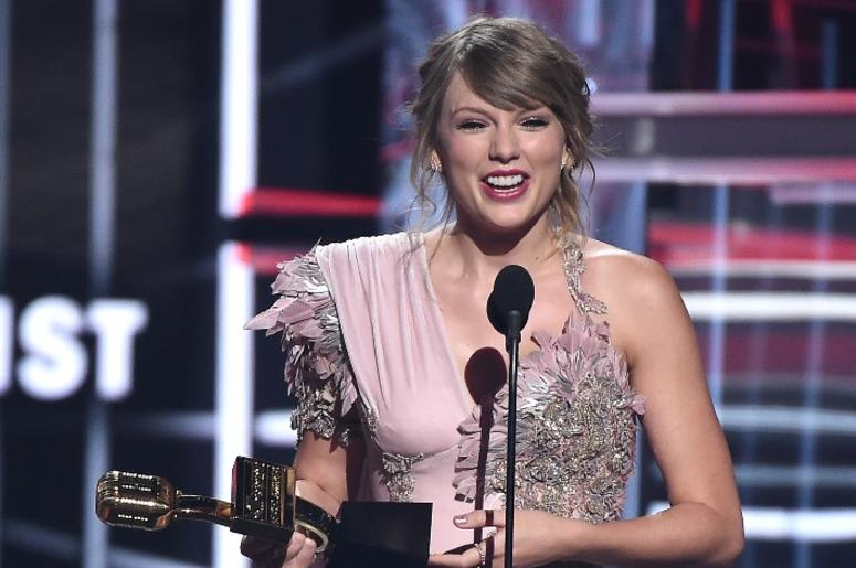 Taylor Swift accepts an award at the 2018 Billboard Music Awards at MGM Grand Garden Arena on May 20, 2018 in Las Vegas, Nevada.