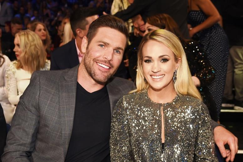 NASHVILLE, TN - JUNE 6: (L-R) Mike Fisher and Carrie Underwood attend the 2018 CMT Music Awards at the Bridgestone Arena on June 6, 2018 in Nashville, Tennessee.