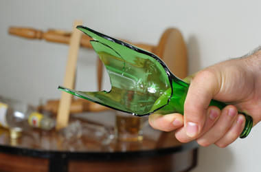 A broken bottle used as a lethal weapon in a bar fight.