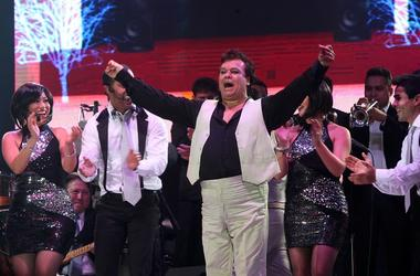 """QUITO, March 14, 2014 (Xinhua) -- Mexican singer and composer, Juan Gabriel (C), performs during a concert of his """"Gracias por cantar mis canciones"""" tour, in the Ruminahui coliseum, in Quito, capital of Ecuador, on March 13, 2014. Juan Gabriel is back in"""