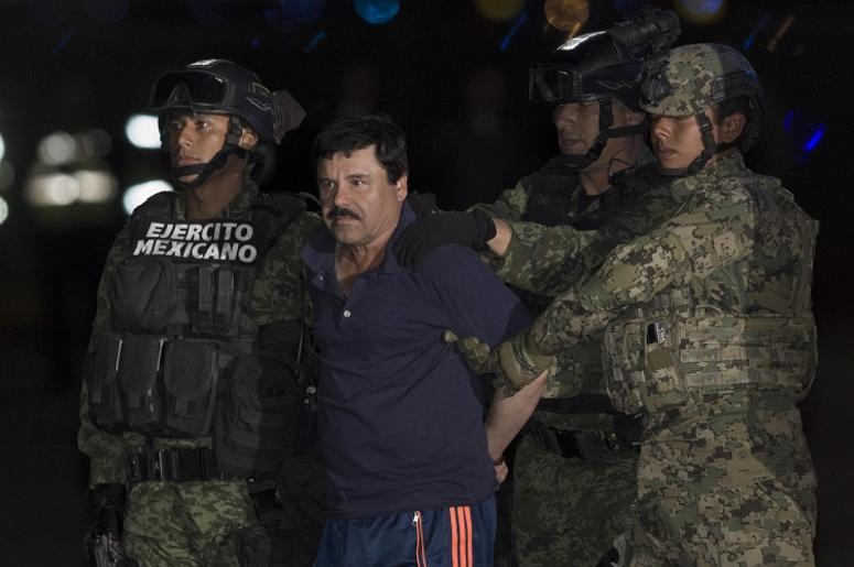 "Soldiers escort Joaquin Guzman Loera, alias ""El Chapo"", upon his arrival to the hangar of the Attorney General's Office, in Mexico City, capital of Mexico, on Jan. 8, 2016"