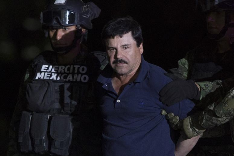 "MEXICO CITY, Jan. 9, 2016 (Xinhua) -- Soldiers escort Joaquin Guzman Loera, alias ""El Chapo"", upon his arrival to the hangar of the Attorney General's Office, in Mexico City, capital of Mexico, on Jan. 8, 2016. After an early morning raid in northwestern"