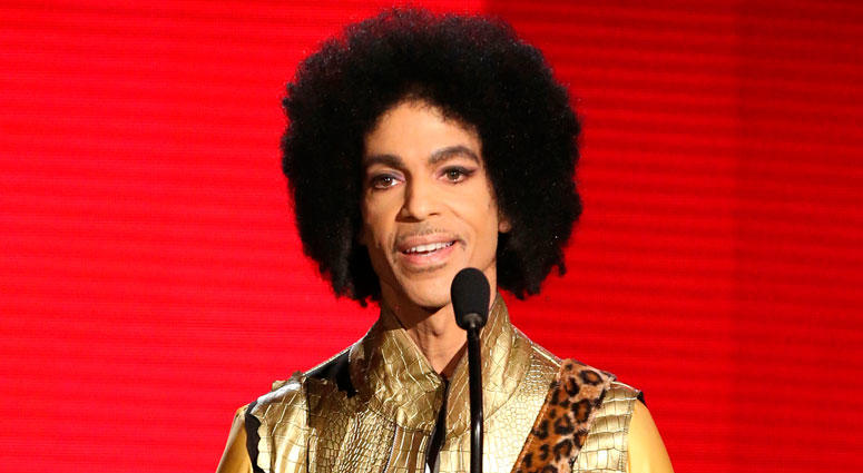 FILE - In this Nov. 22, 2015, file photo, Prince presents the award for favorite album - soul/R&B at the American Music Awards in Los Angeles