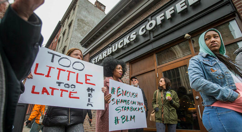 Protesters gather outside of a Starbucks in Philadelphia