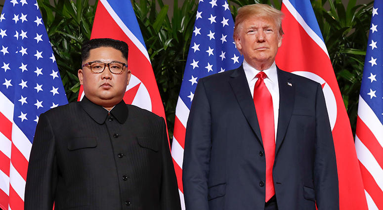 U. S. President Donald Trump stands with North Korea leader Kim Jong Un for a photograph at the Capella resort on Sentosa Island Tuesday, June 12, 2018 in Singapore.