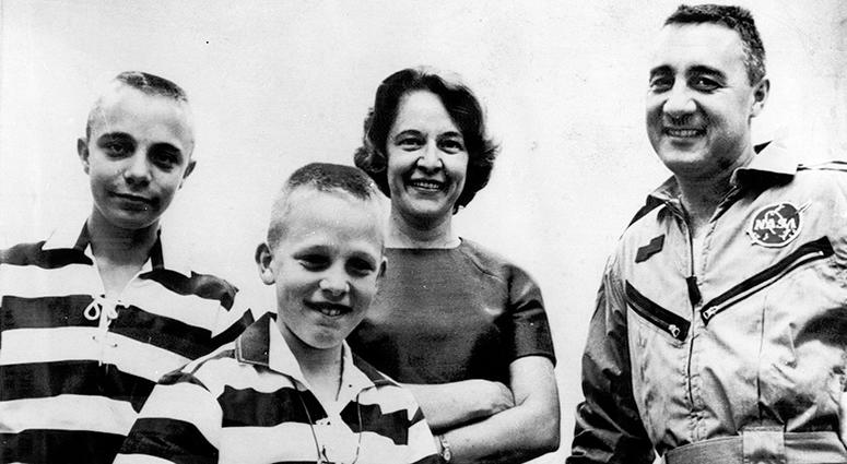 1965 file photo, astronaut Virgil I. Grissom is reunited with his wife and sons at Cape Kennedy, Fla., after his three-orbit flight.