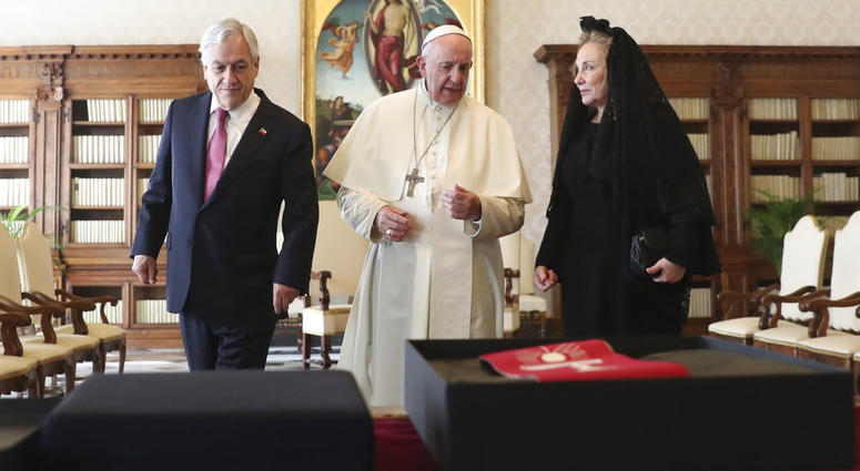 Pope Francis speaks as he meets with Chile's President Sebastian Pinera