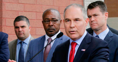 "FILE - In this April 19, 2017, file photo, Environmental Protection Agency Administrator Scott Pruitt speaks at a news conference with Pasquale ""Nino"" Perrotta, second from left, in East Chicago, Ind."