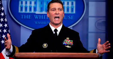 In this Jan. 16, 2018, file photo, White House physician Dr. Ronny Jackson speaks to reporters during the daily press briefing in the Brady press briefing room at the White House, in Washington. Now it's Washington's turn to examine Jackson. The doctor to