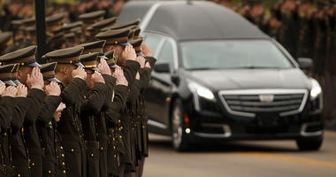 The hearse carrying former first lady Barbara Bush passes through members of the Texas A&M Corps of Cadets as it nears her husband's presidential library at the university on Saturday, April 21, 2018, in College Station, Texas. After an invitation-only fu