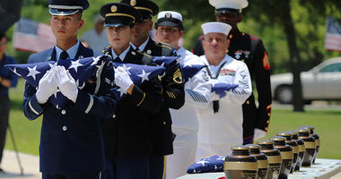 , military service members with the Armed Services Honor Guard prepare to present folded flags as Fort Sam Houston National Cemetery and the Missing In America Project conduct a military burial service for the cremated remains of eight unclaimed veterans