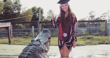 Aggie Grad Poses With Alligator