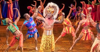 """Gerald  Caesar  as  """"Simba""""  and  company  in  THE  LION  KING  North  American  Tour.  ©Disney."""