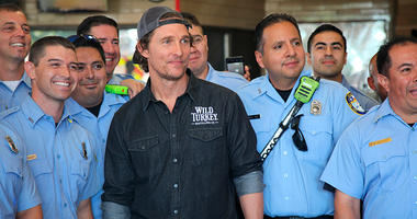 actor Matthew McConaughey posing with first responders in Houston as he surprised them with catered lunches.