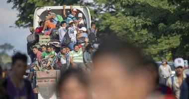 Oct 29, 2018; Mexico; The migrants are hitching rides on trucks and in pickups and cars at an immigration checkpoint as immigration officers watch.
