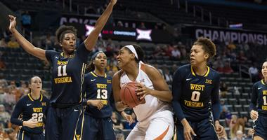 Texas Longhorns forward Jatarie White (40) pulls up to shoot against West Virginia Mountaineers forward Teana Muldrow (11) during the fourth quarter during the women's Big 12 Conference Tournament at Chesapeake Energy Arena.