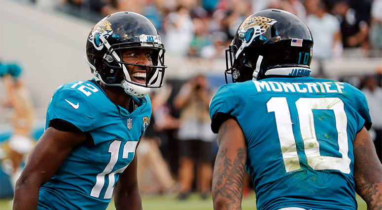 Jacksonville Jaguars wide receiver Dede Westbrook (12) celebrates his 61-yard touchdown against the New England Patriots with teammate wide receiver Donte Moncrief (10)