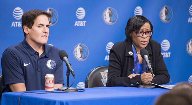 Dallas Mavericks owner Mark Cuban looks on as interim CEO Cynthia Marshall