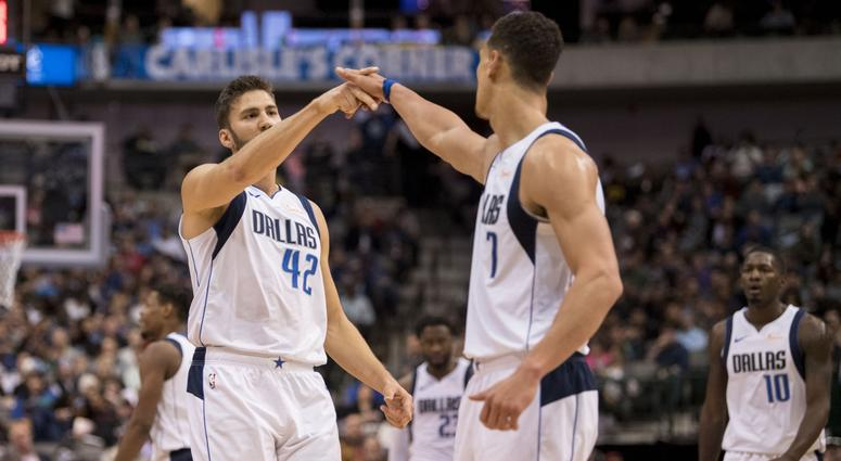 Dallas Mavericks forward Maximilian Kleber (42) and forward Dwight Powell (7) celebrate during the second quarter against the Utah Jazz at the American Airlines Center.