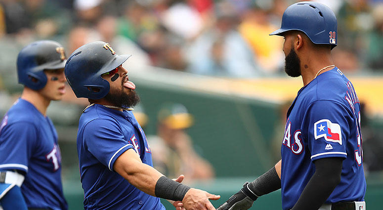 Texas Rangers' Rougned Odor, center, celebrates with Nomar Mazara