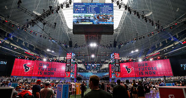 Fans gather on the floor during the NFL football draft at AT&T Stadium in Arlington, Texas, Saturday, April 28, 2018.