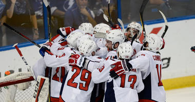 Washington Capitals celebrate after defeating the Tampa Bay Lightning 4-0 in Game 7 of the NHL Eastern Conference finals hockey playoff series Wednesday, May 23, 2018, in Tampa, Fla.
