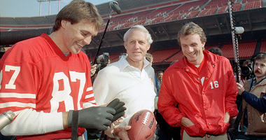 In this Jan. 16, 1985, file photo, San Francisco 49ers' head coach Bill Walsh, center, laughs with quarterback Joe Montana (16) and receiver Dwight Clark, left, at San Francisco's Candlestick Park.