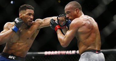 Edson Barboza (red gloves) fights Kevin Lee (blue gloves) during UFC Fight Night at Atlantic City Boardwalk Hall.