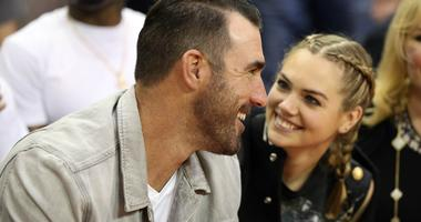 Houston Astros pitcher Justin Verlander talks with his wife model Kate Upton