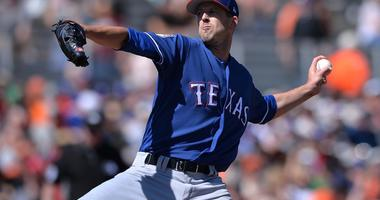 Texas Rangers starting pitcher Drew Smyly (33) works against a San Francisco Giants batter during the first inning at Scottsdale Stadium.