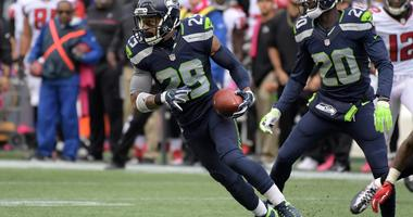 Oct 16, 2016; Seattle, WA, USA; Seattle Seahawks safety Earl Thomas (29) carries the ball on an interception return in the fourth quarter against the Atlanta Falcons during a NFL football game at CenturyLink Field. The Seahawks defeated the Falcons 26-24.