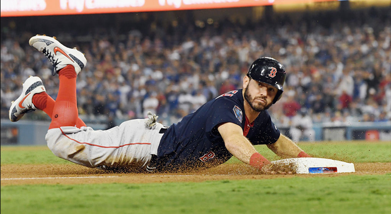 OCTOBER 26: Ian Kinsler #5 of the Boston Red Sox slides in safely to third base against the Angeles Dodgers during the tenth inning in Game Three of the 2018 World Series at Dodger Stadium on October 26, 2018 in Los Angeles, California. (Photo by Harry H
