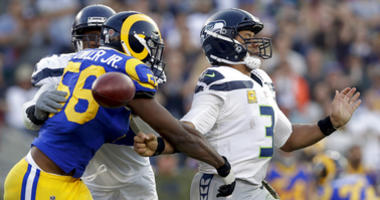 Los Angeles Rams defensive end Dante Fowler forces a fumble by Seattle Seahawks quarterback Russell Wilson during the second half in an NFL football game Sunday, Nov. 11, 2018, in Los Angeles