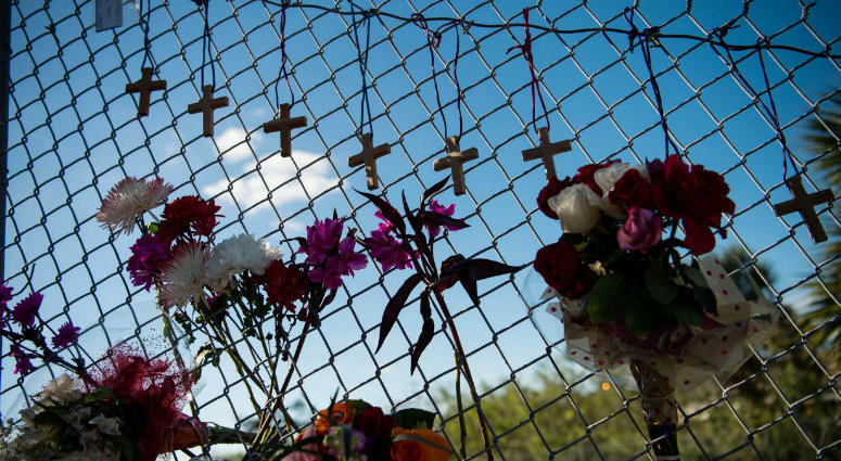 Feb 15, 2018; Parkland, FL, USA; A small makeshift memorial is seen under the Sawgrass Expressway across from the entrance to Marjory Stoneman Douglas High School following Wednesday's mass casualty school shooting.