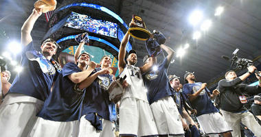 Apr 2, 2018; San Antonio, TX, USA; Villanova Wildcats forward Omari Spellman (14) hoist the national championship trophy after defeating the Michigan Wolverines 79-62 in the championship game of the 2018 men's Final Four at Alamodome.