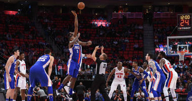 Apr 4, 2018; Detroit, MI, USA; Philadelphia 76ers center Amir Johnson (5) and Detroit Pistons guard Luke Kennard (5) during the opening tip off during the game at Little Caesars Arena.