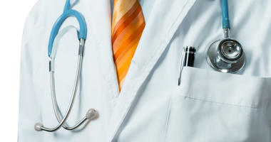 Doctor In White Medical Coat With Stethoscope.