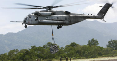 FILE - In this Saturday Oct. 10, 2009, file photo, a U.S. military helicopter, the CH-53E Super Stallion, airlifts humanitarian aid to be dropped in affected regions around Pariaman, north of Padang, Indonesia. On Tuesday, April 3, 2018, a CH-53E Super St