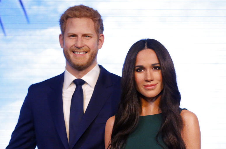 Britain's Prince Harry and his fiancee Meghan Markle are on display as wax figures at Madame Tussauds in London.