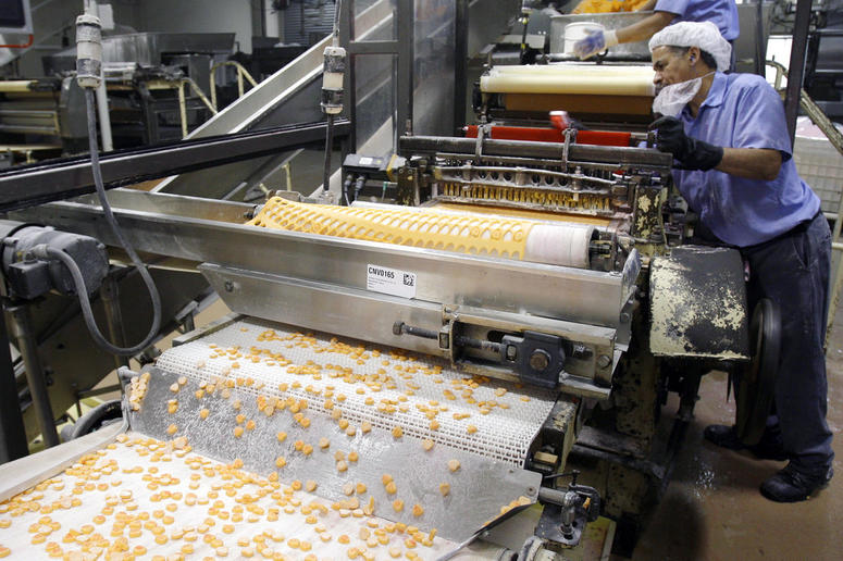 Sweethearts candy drop onto a conveyor belt as they are manufactured at the New England Confectionery Company.
