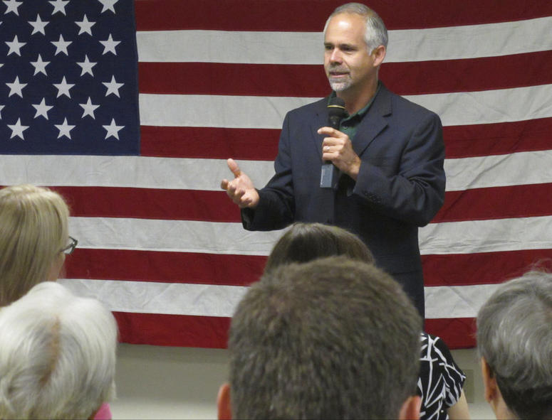 Then-Rep. Tim Huelskamp, R-Kan., speaks during a campaign town hall meeting at the headquarters of Patriot Outfitters, which sells firearms, accessories and hunting and military gear in St. Marys, Kan.