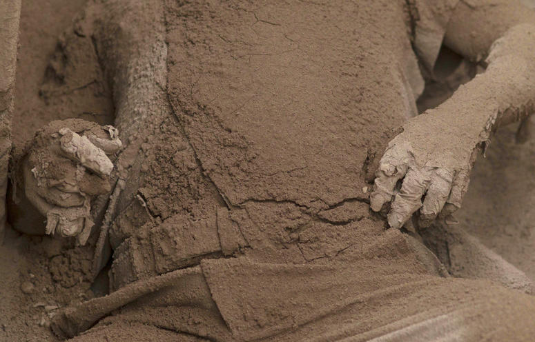 The body of a victim is covered in volcanic ash spewed by the Volcan de Fuego.