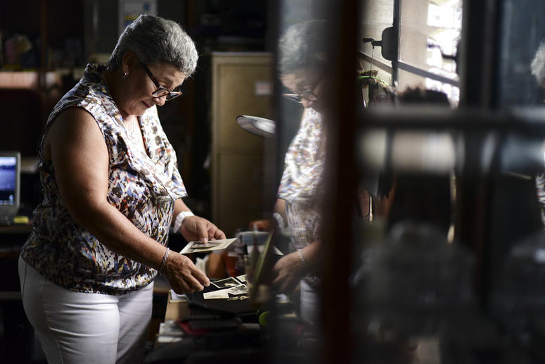 Nerybelle Perez goes through photographs of her father, World War II veteran Efrain Perez, who died inside an ambulance after being turned away from the largest public hospital when it had no electricity or water, days after Hurricane Maria passed.