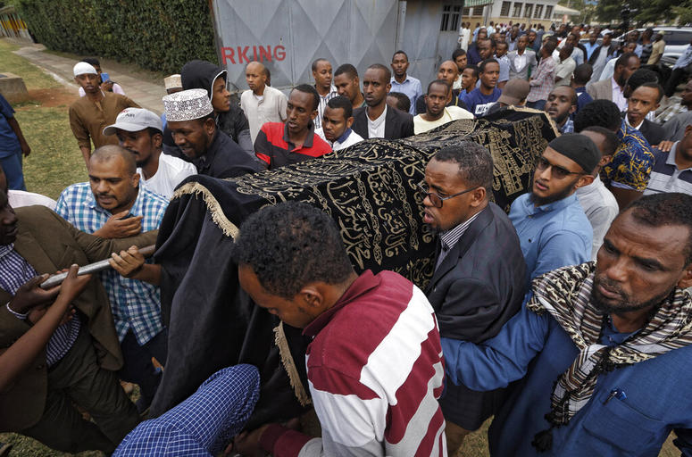 Mourners carry the body of Feisal Ahmed, who was killed with his colleague Abdalla Dahir in Tuesday's attack, as they leave a mosque and head to the funerals in Nairobi, Kenya Wednesday, Jan. 16, 2019.