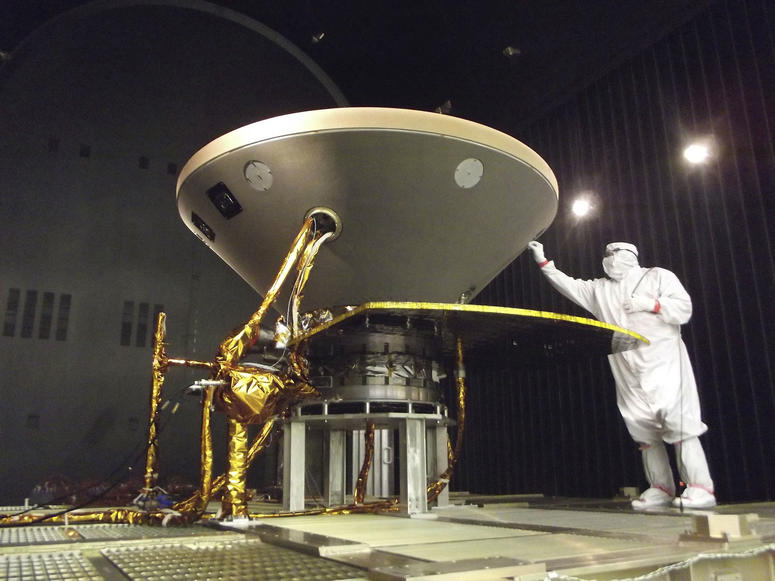 "In this 2015 photo made available by NASA, a technician prepares the InSight spacecraft for thermal vacuum testing in its ""cruise"" configuration for its flight to Mars, simulating the conditions of outer space at Lockheed Martin Space Systems in Denver."